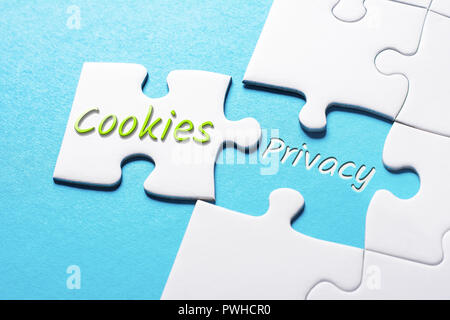 The Words Cookies And Privacy In Missing Piece Jigsaw Puzzle - Stock Image