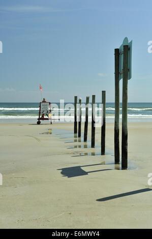 lifeguard and vertical poles on Daytona Beach, Florida, USA - Stock Image