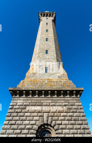 Penmarch, France - August 2, 2018: Eckmuhl Lighthouse in the Point Penmarch, low angle view against blue sky - Stock Image