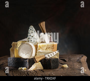 Assortment of different cheese types on wooden background. Cheese background. - Stock Image