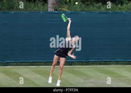 Jennifer Brady, American tennis player, serves during a match. Tennis serve, female tennis. - Stock Image