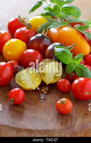 A colorful selection of heirloom tomato cultivars, food diversity concept - Stock Image