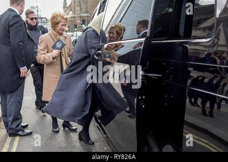 A newly-appointed lady QC (Queen's Council (aka 'silk' in legal vernacular) climbs into a London cab after being sworn in to her latest position at the House of Commons, on 11th March 2019, in London, England. - Stock Image