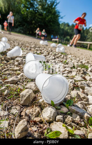 Discarded plastic water cups dropped by running competitors in the Sherwood Pines 10k.. - Stock Image