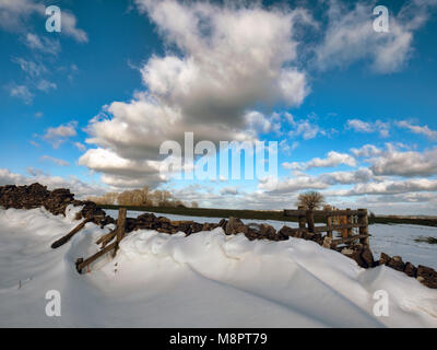 Tissington, Peak District National Park, Derbyshire, UK. 19th March, 2018. UK Weather: The last of the drifted snow - Stock Image