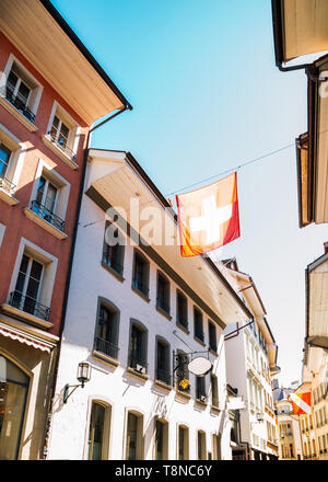 Thun old town street, Colorful buildings and flag in Switzerland - Stock Image