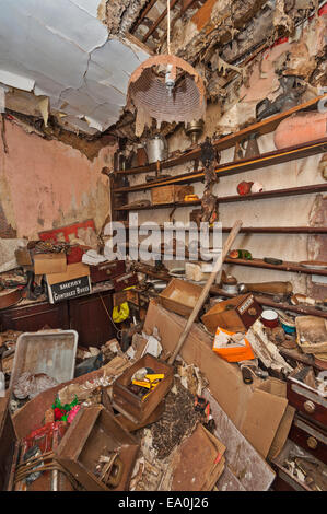 A derelict storeroom in an abandoned and collapsing house - Stock Image