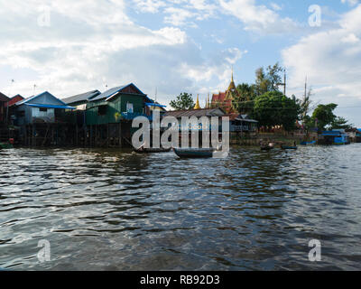 Khmer style Pagoda in Kampong Phluk floating village Siem Reap Cambodia Asia inhabitants paddling canoes along Kampong Phluk River from their Stilted  - Stock Image