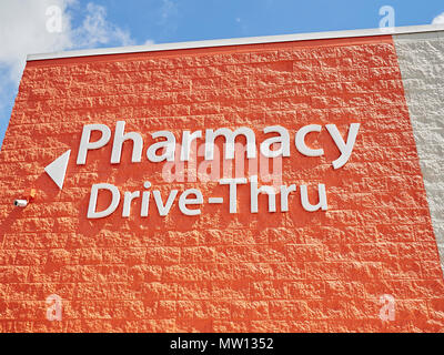 Pharmacy Drive-Thru outdoor exterior sign on a building in Montgomery Alabama, USA. - Stock Image