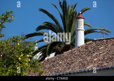 Portugal, Algarve, Silves, Rooftop & Chimney - Stock Image