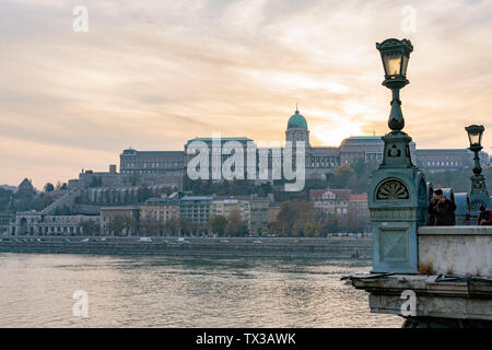 Sunset view of the Buda Castle with River Danube at Budapest, Hungary - Stock Image