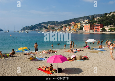 Villefranche sur Mer, the beach and holidaymakers, South of France - Stock Image