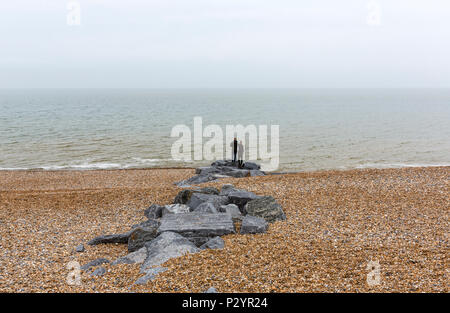 Couple at the Beach, Hastings, East Sussex, England , UK - Stock Image