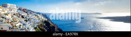 Panoramic view of the caldera of Santorini including the town of Fira with cliffs sea and a moored cruise ship in - Stock Image