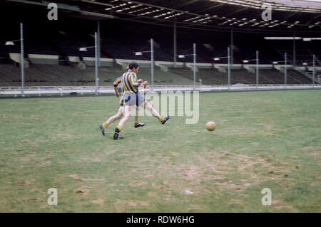 1970s, Wembley Stadium, two amateur footballers having a kick about on the famous turf, Wembley, London, England, UK - Stock Image