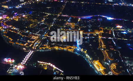 Taierzhuang, China. 16th Feb, 2019. Aerial photo taken on Feb. 16, 2019 shows the night view of the ancient town of Taierzhuang in east China's Shandong Province. Credit: Wang Kai/Xinhua/Alamy Live News - Stock Image