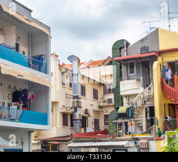 Exhaust chimney rear of restaurant in laneway Choo Chiat Singapore - Stock Image