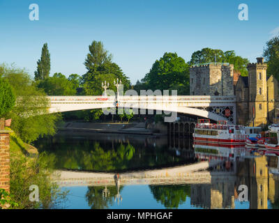 City Cruise boats moored by the Lendel bridge on the River Ouse in York City Centre - Stock Image