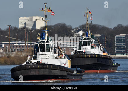 Tugs Peter and Michel in action - Stock Image