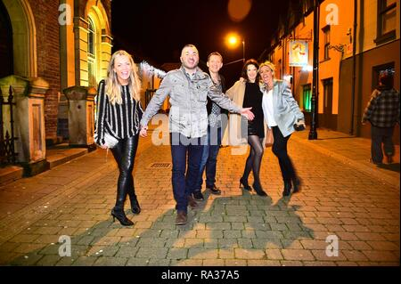 Aberystwyth, Wales, UK. 31st December 2018. People out on the streets celebrating the start of the new year 2019 in Aberystwyth on the west coast of Wales   Credit: keith morris/Alamy Live News - Stock Image