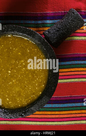 Stock image of mexican salsa verde on mortar and pestle - Stock Image