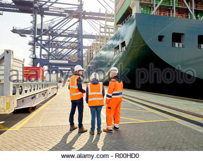Dock workers by cargo ship at Port of Felixstowe, England - Stock Image