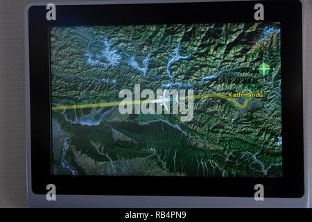 Passenger jet on-screen map showing departure from Kathmandu, Nepal, Asia - Stock Image