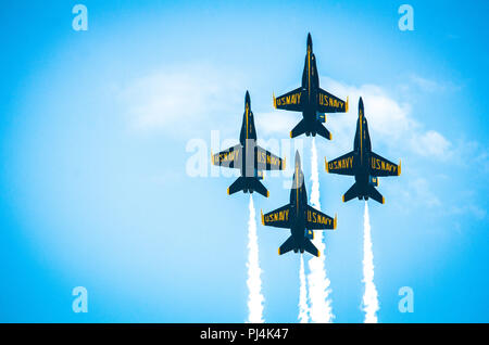 A formation of U.S. Navy F-18 Hornets, assigned to the Navy Flight Demonstration Squadron, the Blue Angels, fly overhead during the Sound of Speed Airshow at Rosecrans Air National Guard Base, St. Joseph, August 26, 2018. The air show was hosted by the 139th Airlift Wing, Missouri Air National Guard and city of St. Joseph to thank the community for their support. The air show committee estimated around 70,000 people attended the weekend performances. The Blue Angels strive to showcase the pride and professionalism of the United States Navy and Marine Corps by inspiring a culture of excellence  - Stock Image