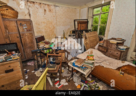 The bedroom of an abandoned and tumbledown house in Lincolnshire - Stock Image