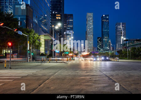 High-rise buildings in Futian Central Business District (CBD) illuminated at dusk. Shenzhen, Guangdong Province, China. - Stock Image