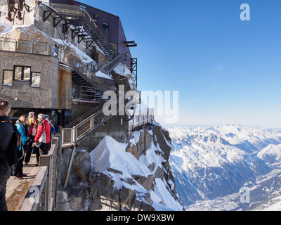 People on bridge viewing platform at Aiguille du Midi top téléphérique cable-car station. Chamonix-Mont-Blanc Rhone-Alpes France - Stock Image
