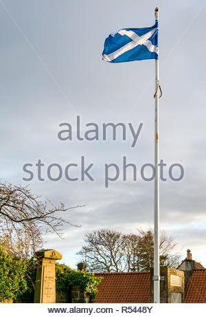 Athelstaneford, East Lothian, Scotland, United Kingdom, 29th November 2018. Birthplace of St Andrew's Cross, the saltire flag. On the eve of St Andrew's Day the Scottish National Flag Heritage Centre saltire flag blows in the wind. Legend says that on the eve of a battle between Picts and Angles from Northumbria in 832AD Saint Andrew had a vision of victory and when the Picts saw a white cross formed by clouds in a blue sky they attributed their victory to his blessing, adopting the cross as a flag - Stock Image