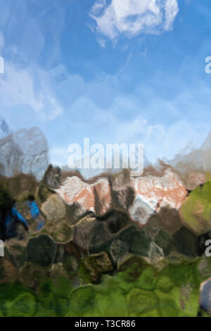 A blurred view of suburban houses in Redditch through a patterned glass window, UK - Stock Image