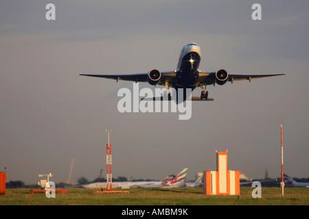 British Airways Boeing 777 taking off at Heathrow Airport London UK - Stock Image