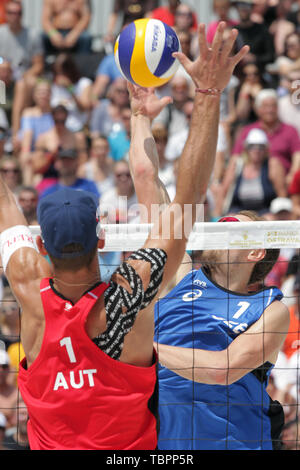 Ostrava, Czech Republic. 01st June, 2019. L-R Martin Ermacora (Austria) and Ondrej Perusic (Czech) in action during the four-star J&T Banka Ostrava Beach Open 2019, part of the FIVB Beach Volleyball World Tour, in Ostrava, Czech Republic, on July 1, 2019. Credit: Petr Sznapka/CTK Photo/Alamy Live News - Stock Image