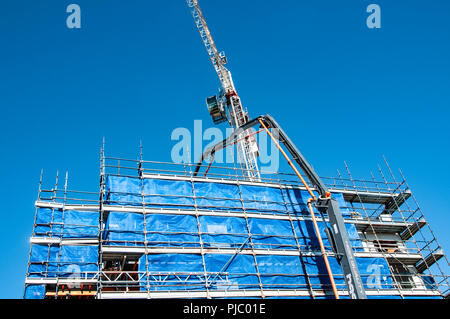 Gosford, New South Wales, Australia - July 7. 2018: Construction and building progress update 101.  Pumping concrete on new home units building site,  - Stock Image