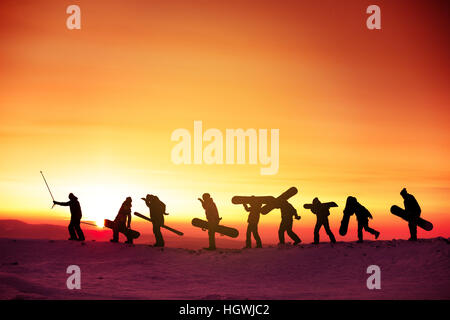 Group team snowboarder ski concept sunset - Stock Image