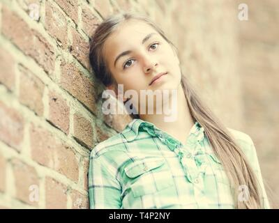 Girl, teenager, 13 years, leaning against a wall, portrait, Germany - Stock Image