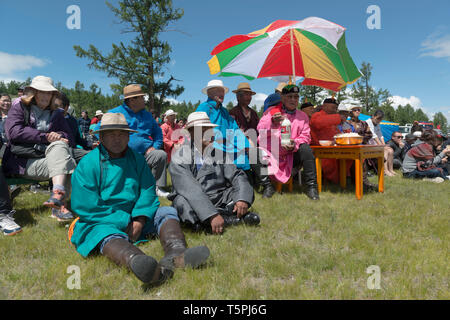 Naadam Festival in Khatgal, Mongolia. Spectators and jury of a wrestling competition - Stock Image