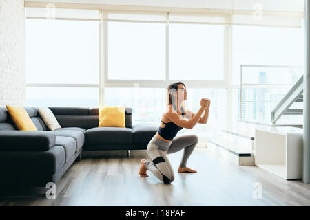 Adult Woman Training Legs Doing In and Out Squat - Stock Image