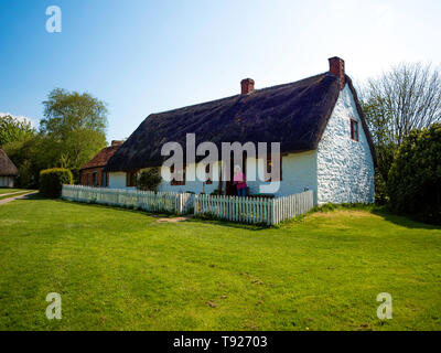 Harome Cottage a double fronted thatched dwelling in the  Ryedale Folk Museum in Hutton le Hole North Yorkshire England UK - Stock Image