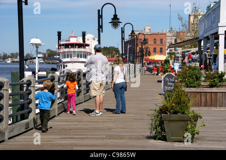 Family on the River walk in Wilmington, NC, North Carolina. - Stock Image