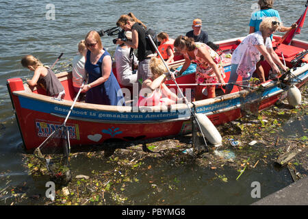 The foundation Plastic Whale is Mmking the Amsterdam canals free of plastic. The boats is made of plastic waste from the Amsterdam canals. - Stock Image