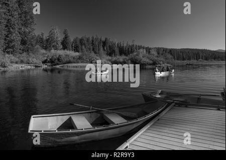 Art print of three boats on a mountain lake - Stock Image