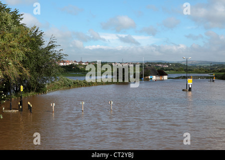 Radipole Lake overflows in Weymouth flooding the car park and bird sanctuary lookout - Stock Image