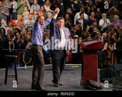 Chicago, Illinois, USA. 4th November 2018. Former President Barack Obama and gubernatorial candidate JB Pritzker wave to the crowd after President Obama's speeck at today's rally. The rally at UIC was a final push preceding the upcoming midterm general election this Tuesday, which many expect will be a wave election in favor of the Democrats. Credit: Todd Bannor/Alamy Live News - Stock Image