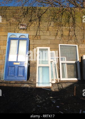 A selection of salvaged doors and windows at a reclamation yard Sheffield UK - Stock Image