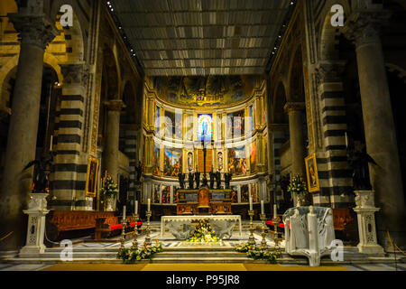 The interior altar featuring renaissance religious artwork inside the Pisa Duomo Cathedral in the Tuscan city of Pisa, Italy. - Stock Image