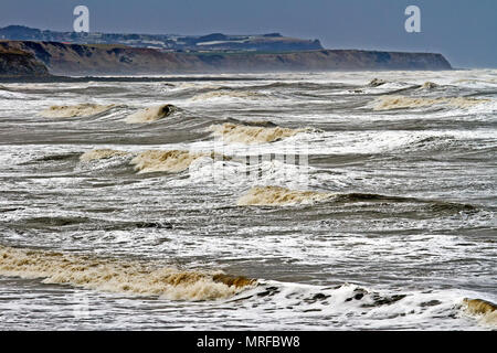 Heavy seas fill Jackson's Bay north of Scarborough, with powerful swells pushing into North Bay. - Stock Image