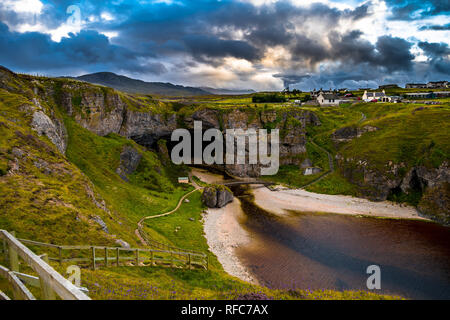 Entrance And Path With Bridge To Smoo Cave Near Durness In Scotland - Stock Image